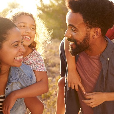 A black family smiling and being exceedingly happy