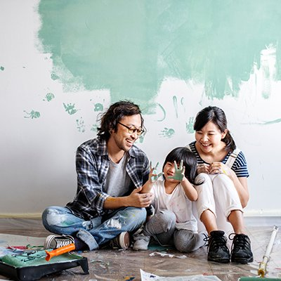A Japanese family resting and goofing around after painting