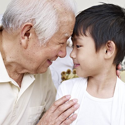A grandpa looking directly into his grandson's eyes