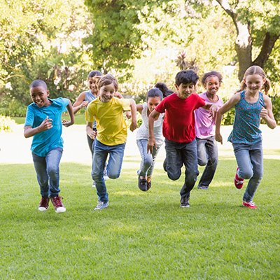A group of children, of all different races, running